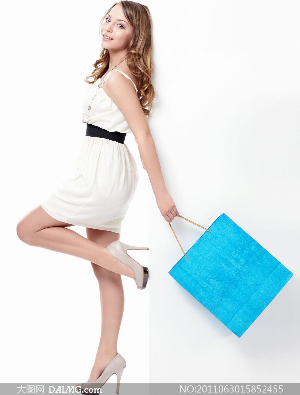 手提购物袋靓丽美女人物高清图片