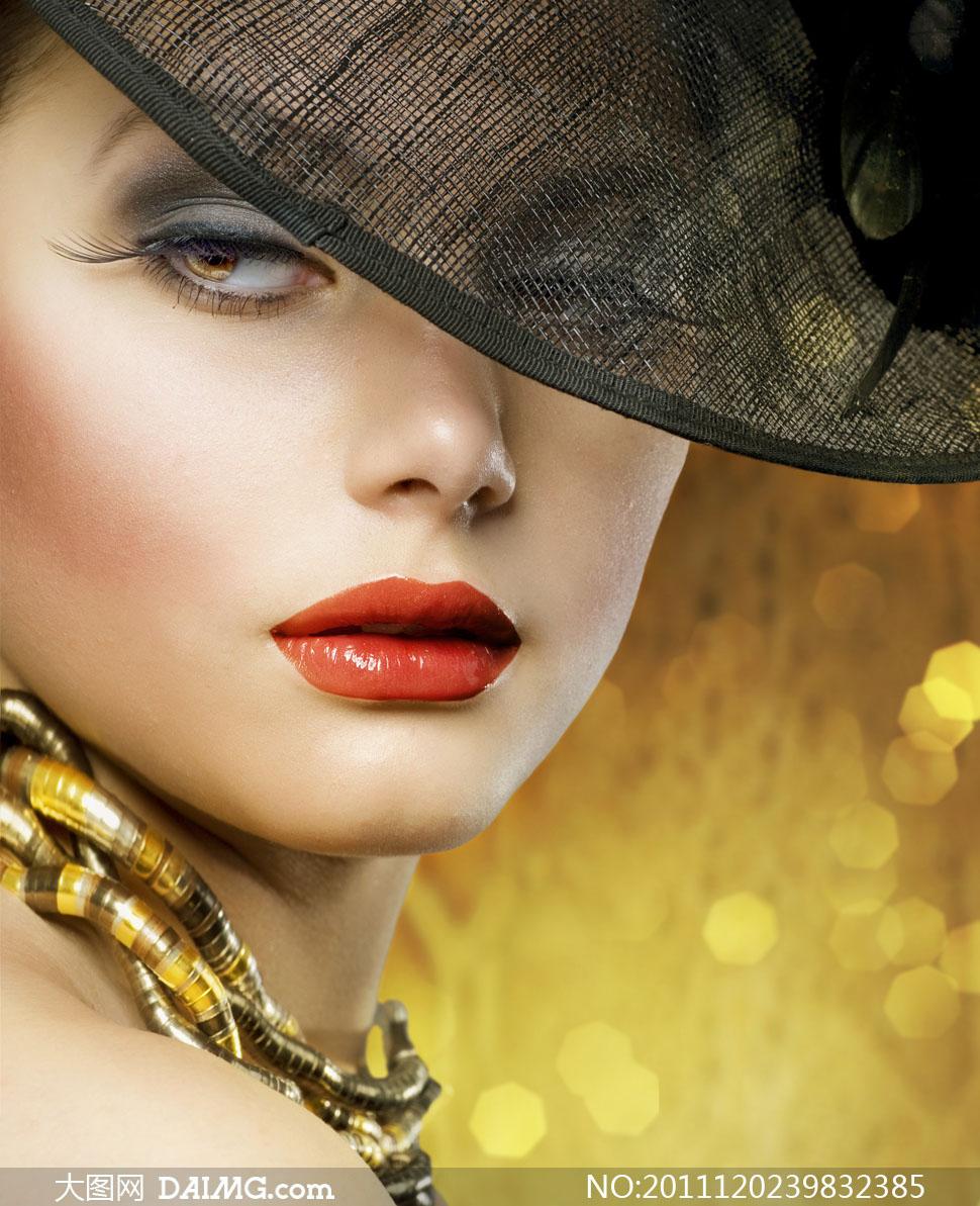 戴着帽子的红唇女人高清摄影图片