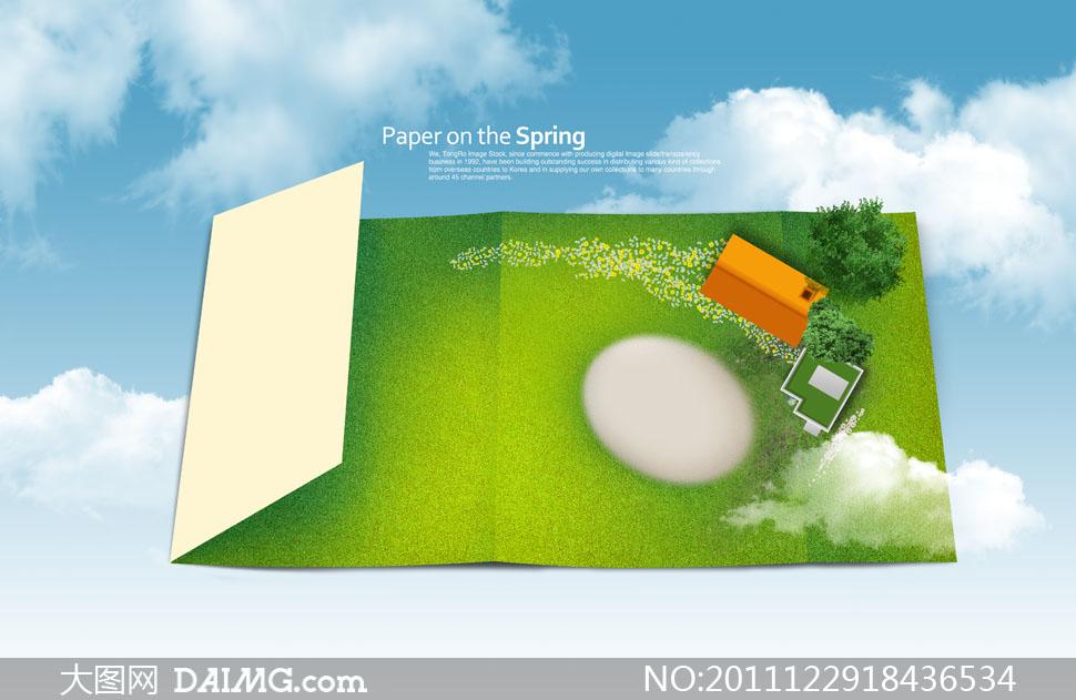蓝天白云与创意纸张俯视图psd分层素材