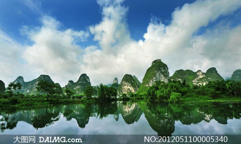 大图首页 高清图片 自然风景 > 素材信息  蓝天白云下的群山和湖水