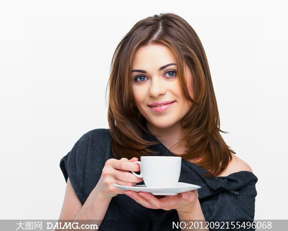 端着咖啡杯的美女人物摄影高清图片
